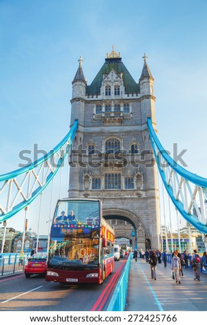 LONDON - APRIL 14: Tower bridge with touristic bus on April 14, 2015 in London, UK. It (built 1886-1894) is a combined bascule and suspension bridge in London, England which crosses the River Thames. - stock photo