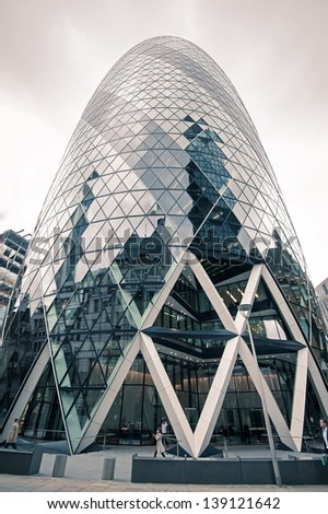 LONDON - APRIL 15: View of the Gherkin building on April 15, 2013 in London. It has become an iconic symbol of London and is one of the city's most widely recognised examples of modern architecture. - stock photo