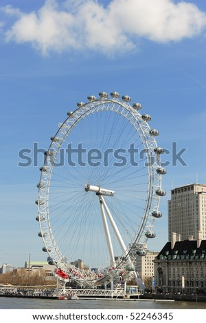 LONDON - APRIL 10: View of The London Eye on April 10, 2010 in London, England. At a height of 135m, it is the tallest Ferris wheel in Europe. - stock photo