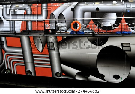 LONDON - APRIL 25. 2015. Wartime dazzle camouflage decorates the 1918 ship HMS President; now a river bar and events venue birthed on the north bank of the River Thames in central London, UK. - stock photo