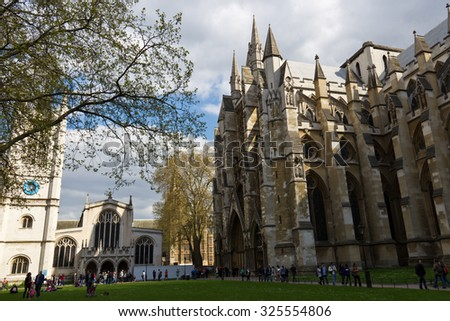 LONDON - April 14, 2014: Westminster Abbey is a large, mainly Gothic abbey church in the City of Westminster, London, located just to the west of the Palace of Westminster. - stock photo