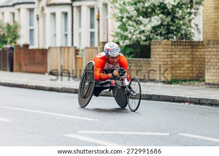 LONDON - APRIL 26: Wheelchair runner in the Virgin Money London Marathon on April 26, 2015 in Isle of Dogs, London, England, UK. - stock photo