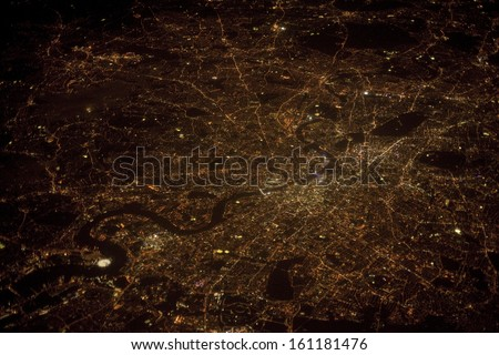 London at night time, aerial photograph taken at 38000 feet altitude on 19th September 2013 - stock photo