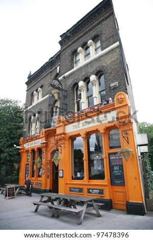 LONDON - AUG 19: Exterior of pub, for drinking and socializing, focal point of the community, on Aug 19, 2010, London, UK. Pub business, now about 53,500 pubs in the UK, has been declining every year - stock photo