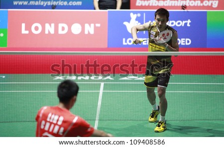 LONDON AUG 14: Lee Chong Wei of Malaysia plays China's Lin Dan at the men's singles final of the World Badminton Championships at Wembley Arena in London on August 14, 2011. Lin Dan won 2-1. - stock photo