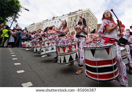LONDON - AUG 29: Members of the Batala Band performing at Notting Hill Carnival on August 29, 2011 in London, England. - stock photo