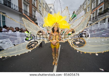 LONDON - AUG 29: Performer takes part in the Notting Hill Carnival on August 29, 2011 in London, England. The annual carnival,  the largest in Europe, takes place every August Bank Holiday since 1966. - stock photo