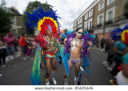 LONDON - AUG 29: Performers take part in the Notting Hill Carnival on August 29, 2011 in London, England. The annual carnival,  the largest in Europe, takes place every August Bank Holiday since 1966.