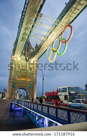 LONDON - AUG 6, 2012: Tower Bridge at night with Olympic rings during London 2012 Olympic Games in London on August 6, 2012. Tower Bridge, One of the most famous bridges in the world. - stock photo