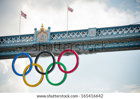 LONDON - AUG 6, 2012. Tower Bridge with Olympic rings during London 2012 Olympic Games in London on August 6, 2012. Tower Bridge, One of the most famous bridges in the world. - stock photo