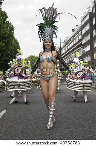 LONDON - AUGUST 31: A dancer from the London School of Samba float during the Notting Hill Carnival on August 31, 2009 in London, England. - stock photo