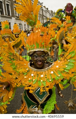 LONDON - AUGUST 25: A dancer from the Paraiso School of Samba during the Notting Hill Carnival  on August 25, 2008 in Notting Hill, London.