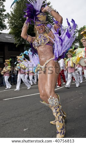 LONDON - AUGUST 31: A dancer from the Paraiso School of Samba float during the Notting Hill Carnival on August 31, 2009 in London, England. - stock photo