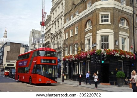 LONDON - AUGUST 11: A London bus at Cannon Street, London. London buses are increasingly fuel efficient. August 11, 2015 in London.