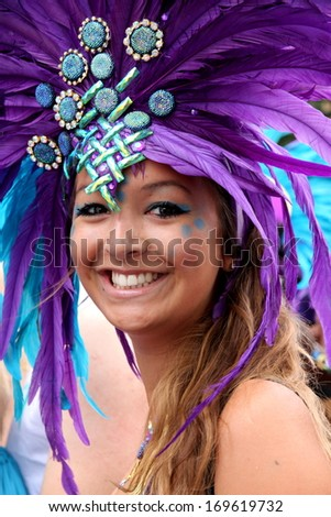 LONDON - AUGUST 27: A performer takes part in the third day of the Notting Hill Carnival, the largest in Europe, on August 27, 2012 in London, UK. Carnival takes place over three days in every August.