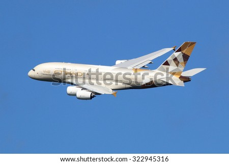 LONDON - AUGUST 28: An Etihad Airways Airbus A380 taking off on August 28, 2015 in London. The Airbus A380 is the world's largest passenger airliner. Etihad is an airline based in Abu Dhabi. - stock photo