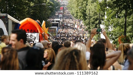 LONDON - AUGUST 26: Crowds of Notting Hill Carnival, largest in Europe, more than one million visitors are expected, on August 26, 2012, London, UK. Carnival takes place over two days in every August. - stock photo