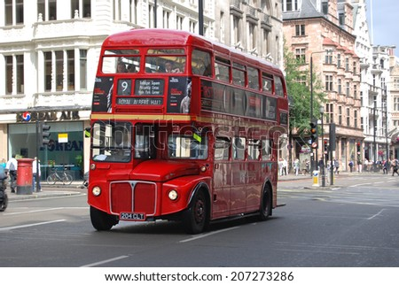 LONDON - AUGUST 4, 2008: Double Decker bus in London, England. These buses are common modes of transportation tourists use while sightseeing in London.  - stock photo