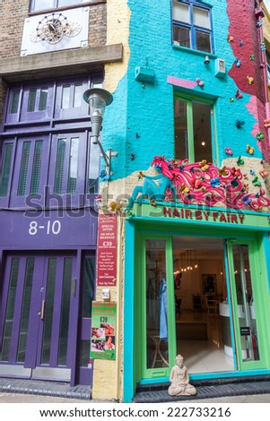 LONDON -AUGUST 16: Houses at Neal's Yard on August 16, 2014 in London. Neal's Yard is  is a small alley in Covent Garden  that nowadays contains several health food cafes and New Age retailers - stock photo