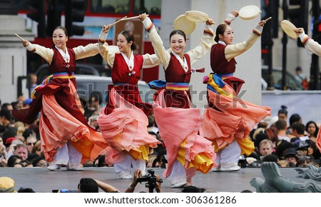 LONDON - AUGUST 9: Korean ethnic dancers perform, Hand Drum Dance, drum dance, in the Korean Festival at Trafalgar Square on August 9, 2015 in London, UK.     - stock photo