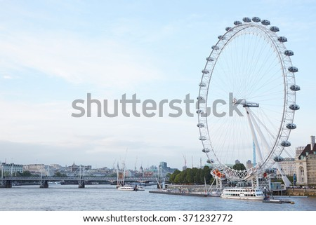 LONDON - AUGUST 4, 2015: London eye, ferris wheel in a summer afternoon, Thames river view on August 4th, 2015 in London, UK. The structure, erected in 1999, the wheel has a diameter of 394 feet.