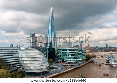 LONDON -AUGUST 6: London Skyline with City Hall, Shard, River Thames on August 6, 2014 in London .The Shard (London Bridge), is the tallest building in Europe, standing approximately 306 metres.  - stock photo