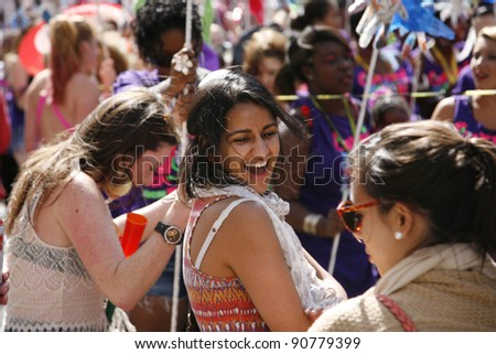 LONDON - AUGUST 28: Performers take part in the first day of Notting Hill Carnival, largest in Europe, on August 28, 2011 in London, UK. Carnival takes place over two days in every August. - stock photo