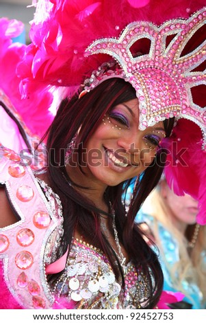 LONDON - AUGUST 30: Performers take part in the second day of Notting Hill Carnival, largest in Europe, on August 30, 2010 in London, UK. Carnival takes place over two days in every August. - stock photo