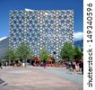 LONDON - AUGUST 3. Ravensbourne is a university college for digital media and design in a distinctive patterned building next to the O2 Dome on the Greenwich Peninsula; August 3, 2013, in London, UK. - stock photo