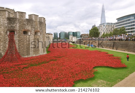 LONDON - AUGUST 30. Some of the 888,246 ceramic poppies on August 30, 2014 commemorate the British and colonial military who died in the 1914-1918 First World War, installed at the Tower of London. - stock photo