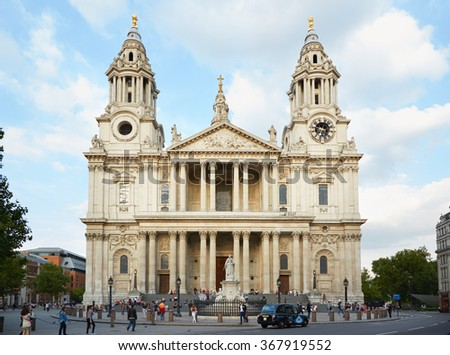 LONDON - AUGUST 7, 2015: St Paul cathedral facade with people on August 7, 2015 in London, UK. Saint Paul is an Anglican cathedral that sits on the highest point of the City of London.