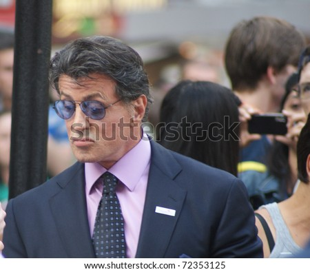 LONDON - AUGUST 9: Sylvester Stallone greets fans as he arrives at the UK Premiere of 'The Expendables' in Leicester Square on August 9, 2010 in London - stock photo
