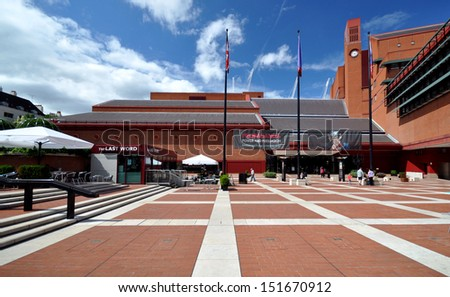 LONDON - AUGUST 4. The British Library holds 150 million books, manuscripts, philatic and cartographic items, music scores and recordings. The landscaped concourse on August 4, 2013 in London, UK.  - stock photo