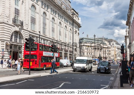 LONDON -AUGUST 4:Typical double decker buses in The Piccadilly St on August 4, 2014 in London.Piccadilly is one of the widest and straightest streets in central London. - stock photo