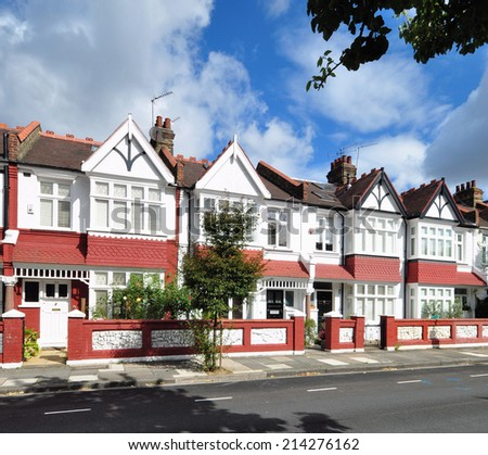 LONDON - AUGUST 21. Typical small Edwardian period townhouses built in 1913 at Rosedew Road on the Crabtree Estate, unusally without parked cars on August 21, 2014 in Hammersmith, west London, UK.