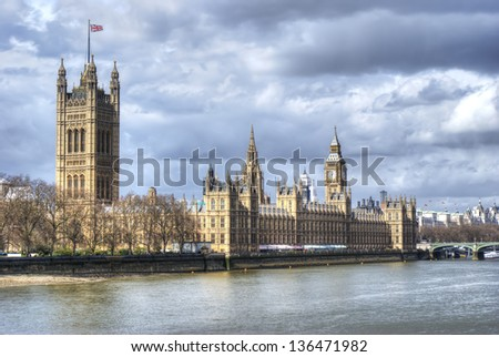London. Beautiful view of government Houses of Parliament and big ben with Thames river - stock photo
