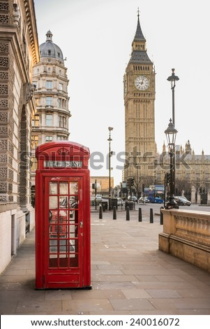 London - Big Ben tower and a red telephone booth - stock photo