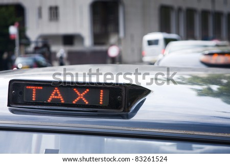 London black cab signs showing 'for hire' - stock photo