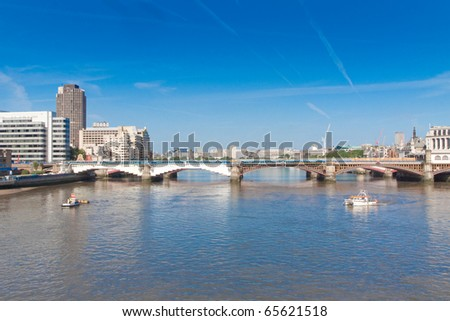 London bridge over River Thames on bright sunny day - stock photo