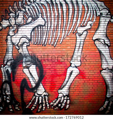 London-circa October 2013 : urban graffiti near Phipp Street. The work is a drawing of a dinosaur skeleton by an unknown artist - stock photo