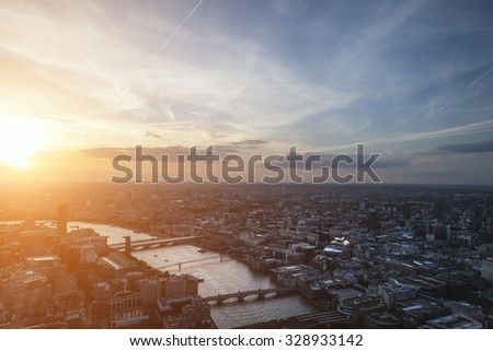 London city aerial view over skyline with dramatic sky