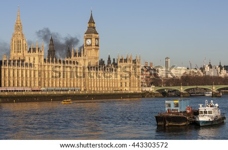 London cityscape showing fire over Big Ben and Westminster - stock photo