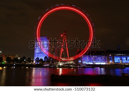 London Cityscape with Millennium Wheel at Night and lights reflected in river LONDON, UK ,   Nov 4 2016.