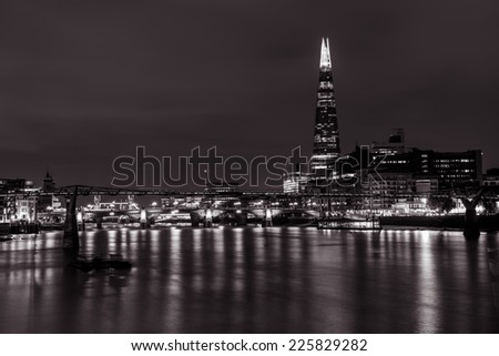 London cityscape with Southwark Bridge and The Shard skyscraper  - stock photo