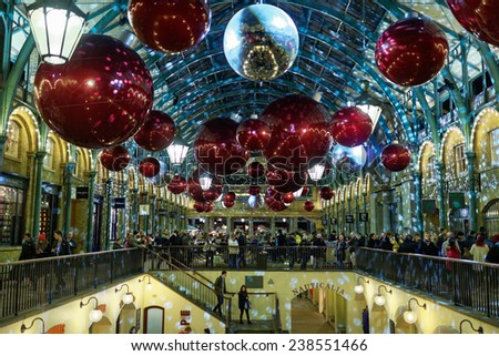 LONDON - DEC 14 : Christmas Lights Display in Covent Garden Market on Dec 14th, 2014, London, UK. The modern colorful Christmas lights attract and encourage people to the market.  - stock photo