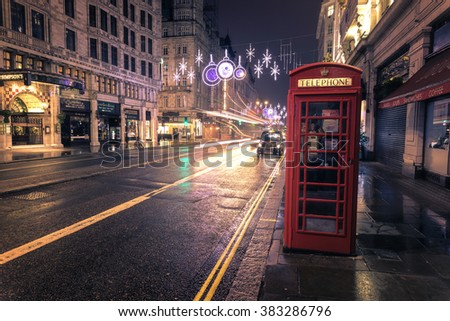 LONDON - DEC 6, 2015 : Christmas Lights Display on Oxford Street on December 6, 2015, London, UK. The modern colorful Christmas lights attract and encourage people to the street. - stock photo
