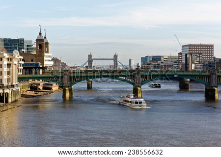 LONDON - DEC 14 : London Tower Bridge and Thames river pictured on Dec 14th, 2014, in London, UK. Built in 1886, it is a combined bascule and suspension bridge in London over the River Thames.  - stock photo