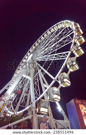 LONDON - DEC 14: Night scene of Hyde Park's winter WonderLand park pictured at night on December 14th, 2014 in London, UK. It is one of the touristic highlight of the winter season in London.  - stock photo
