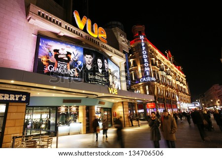 LONDON - DEC 11: Night street view of Leicester Square, pedestrianised square in West End, City of Westminster, centre of London's cinemas also known well as theatreland on Dec 11, 2012 in London, UK - stock photo