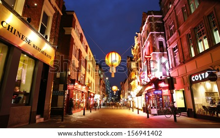 LONDON - DEC 10 : Night view of London ChinaTown, established in 1880 th of Chinese sailors and traders, located in Soho area. a major touristic attraction on Dec 10, 2012, London, UK.  - stock photo